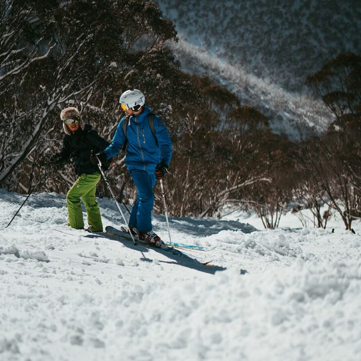 two-people-skiing-on-snow-mountain